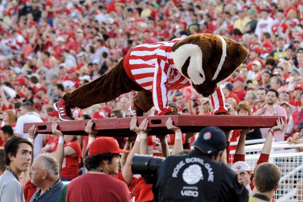 UW-Madison mascot Bucky Badger does another set of pushups following a Wisconsin touchdown during the 2012 Rose Bowl football game between the University of Wisconsin-Madison Badgers and the University of Oregon Ducks.