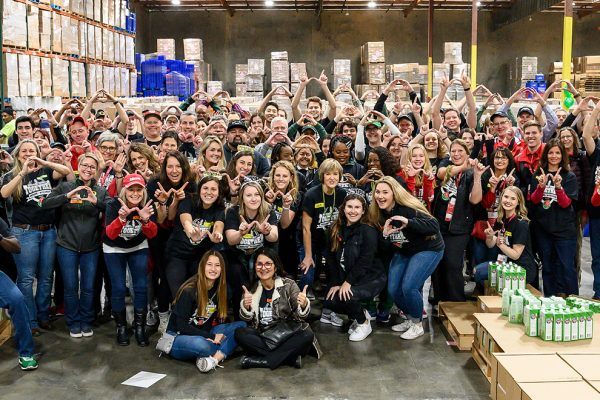 More than 100 volunteers from the University of Wisconsin-Madison and the University of Oregon are pictured at the Los Angeles Regional Food Bank