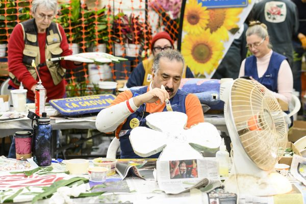 On Dec. 30, 2019, volunteers glue flowers and other natural materials to float elements that will be featured in the Tournament of Roses Parade in Pasadena, California on New Year's Day.