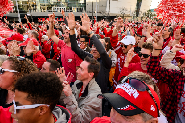 Hundreds of UW Badger fans take part in Jump Around during the UW-Madison Rose Bowl Pep Rally