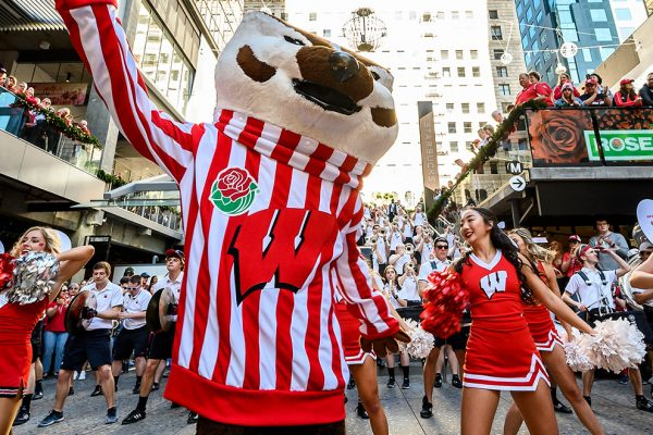 Members of the UW Spirit Squad, the UW Band and UW mascot Bucky Badger