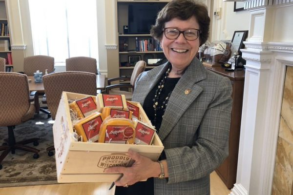 Chancellor Blank holding a box of cheese